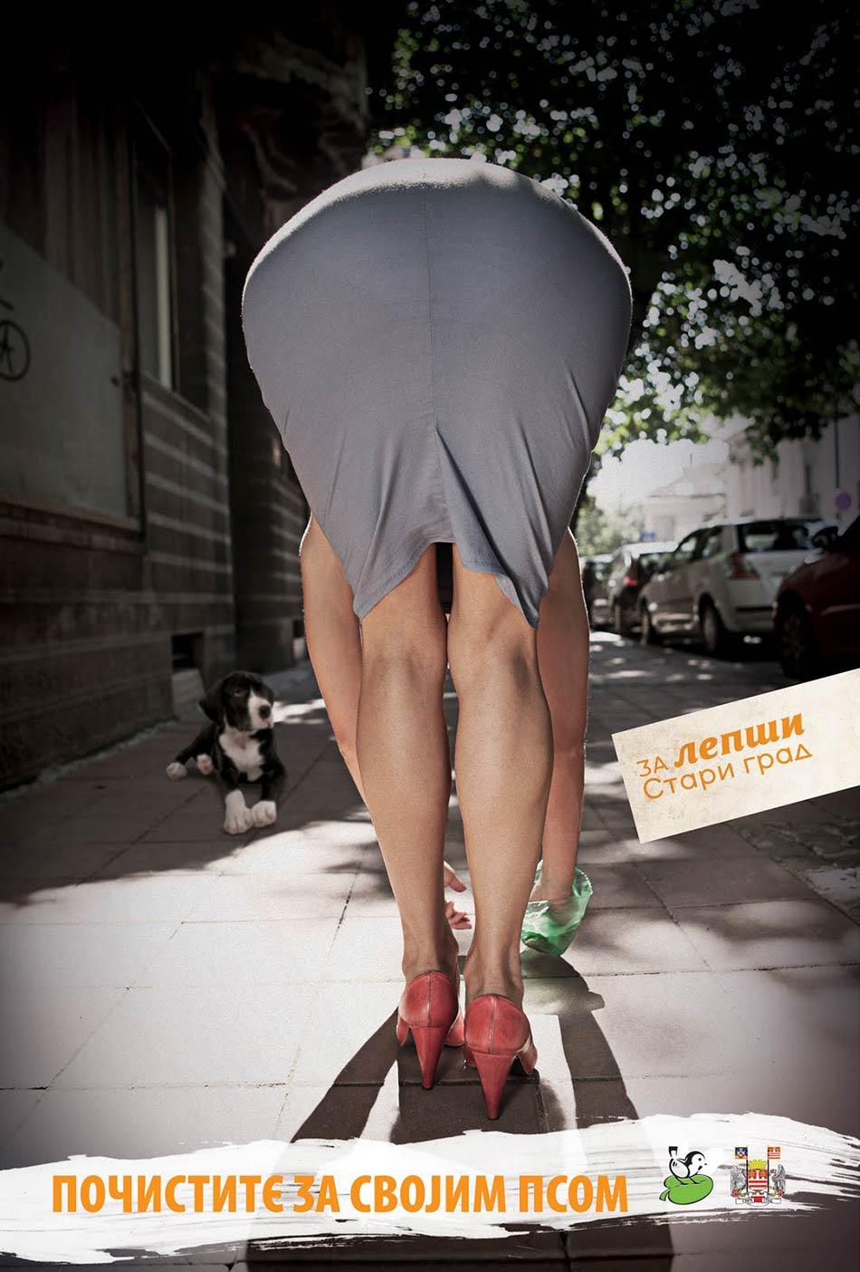 Sagnuta devojka u sivoj suknji čisti: reklamiranje Starog grada Beograda